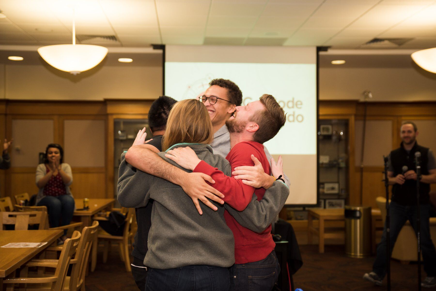 Choozle team members hugging it out at go code colorado